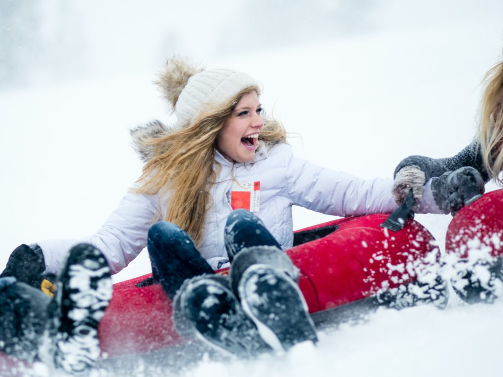 Young woman smiles while tubing