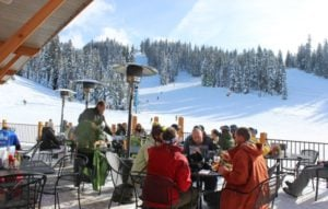 Winter guests enjoy meal on Smoky's deck
