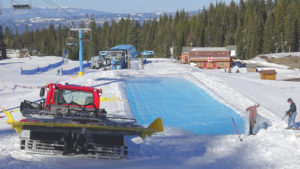 crews prepare the pond for saturday's competition