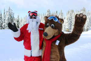Santa poses with Bruno, the Brundage Mascot