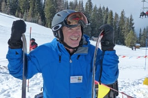 Bob Looper poses for photo with skis