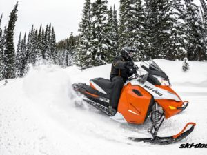 Man rides orange Ski-Doo Snowmobile