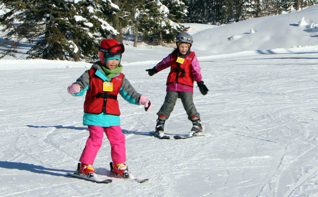 girls in ski lessons