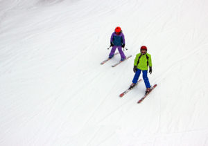 Pair of skiers on Bear Chair