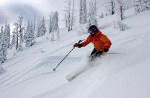 woman skis powder