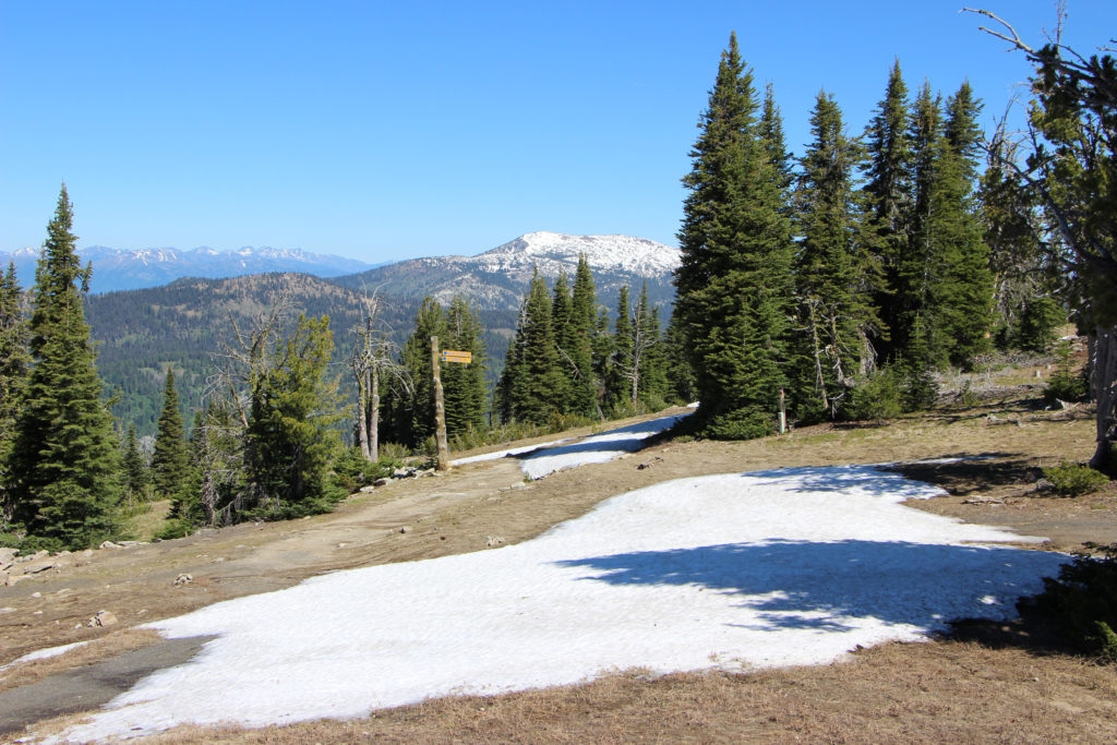 summit photo with snowbanks and Granite Mountain