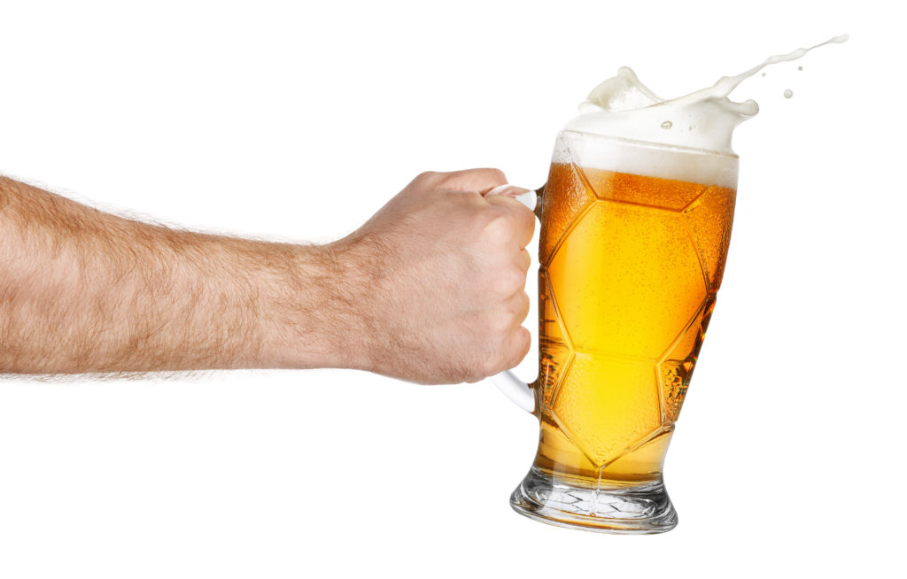 Hand with foamy beer
