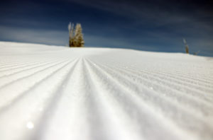 Freshly groomed slope sparkles in the sun