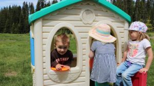 Summer daycare kids play outside