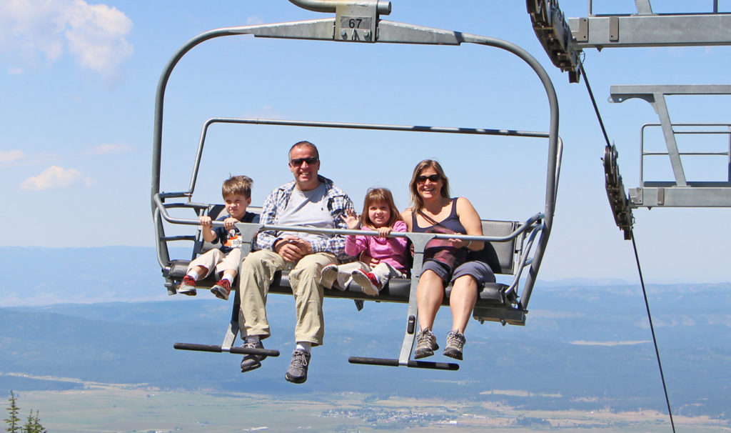 Family waves from chairlift